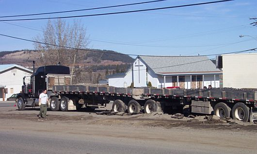 Spring roads may not hold big loads, as the driver of this truck discovered.