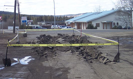 Damage to the municipal road, after the truck sunk almost up to its axles in asphalt