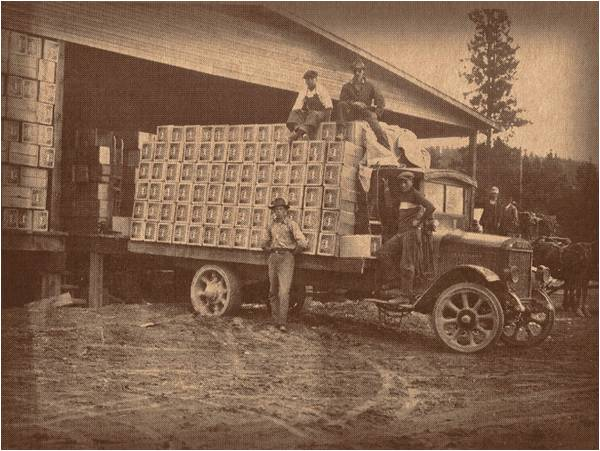 old photo of truck with fruit