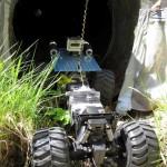 crawler entering culvert