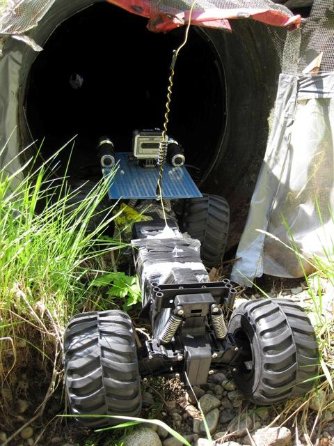 crawler entering culvert