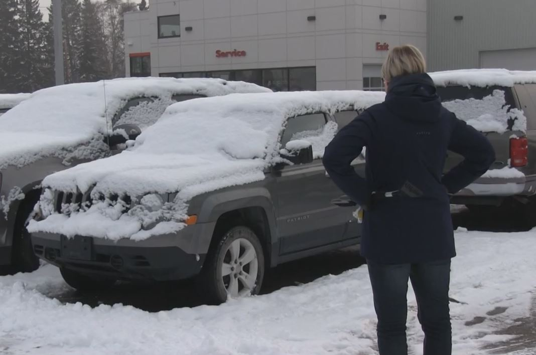 Clearing Snow Off Vehicle