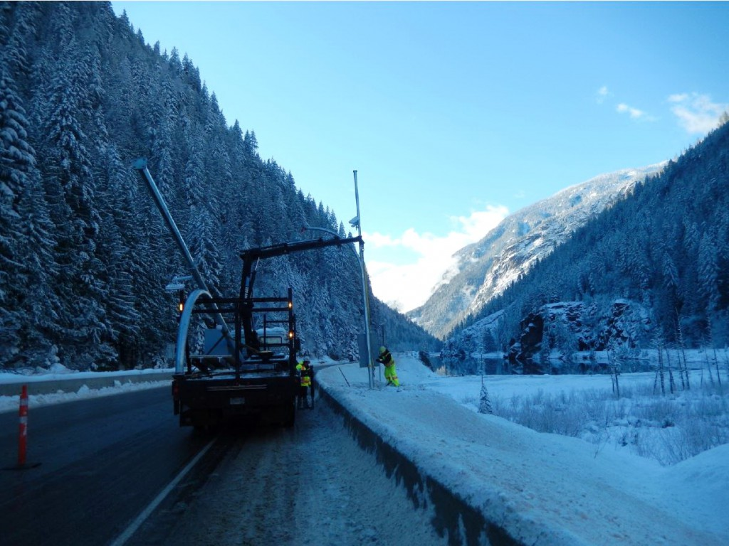 Installing variable speed limit sign on Highway 1 in November, 2015.