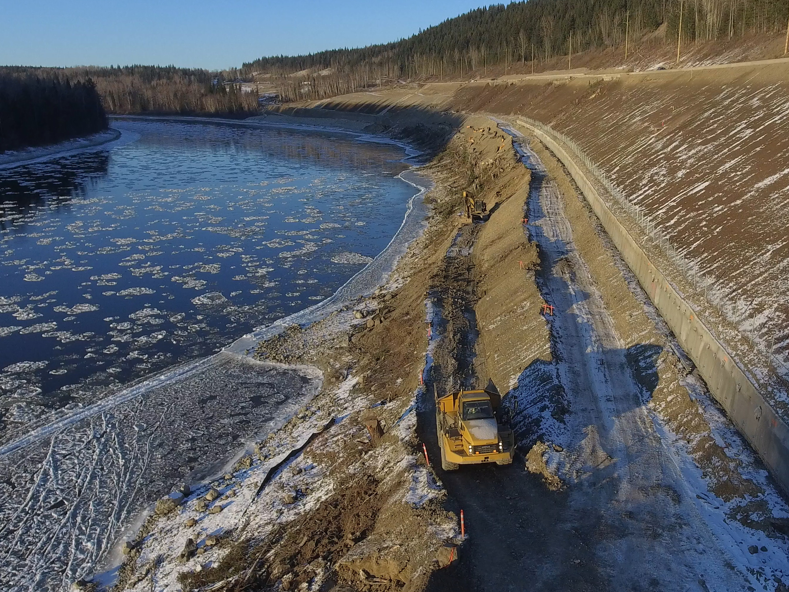 Placing rip-rap, or rock armour, to stabilize the banks along the Fraser River