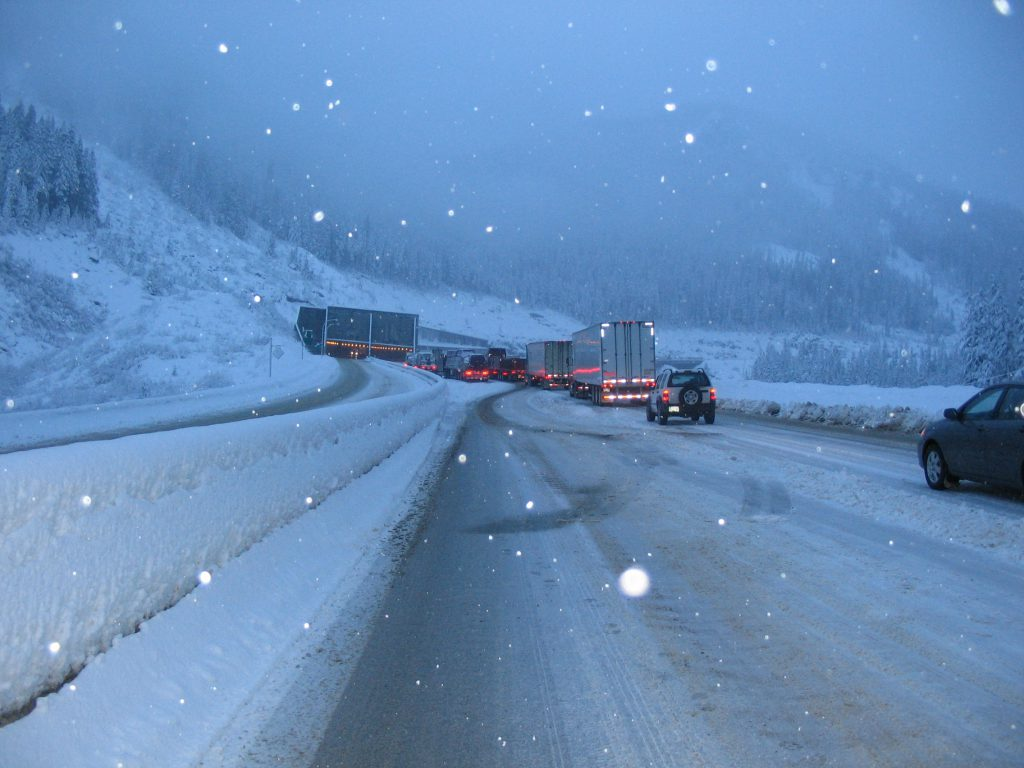 Commercial vehicles blocking traffic during snow storm on Snowshed Hill