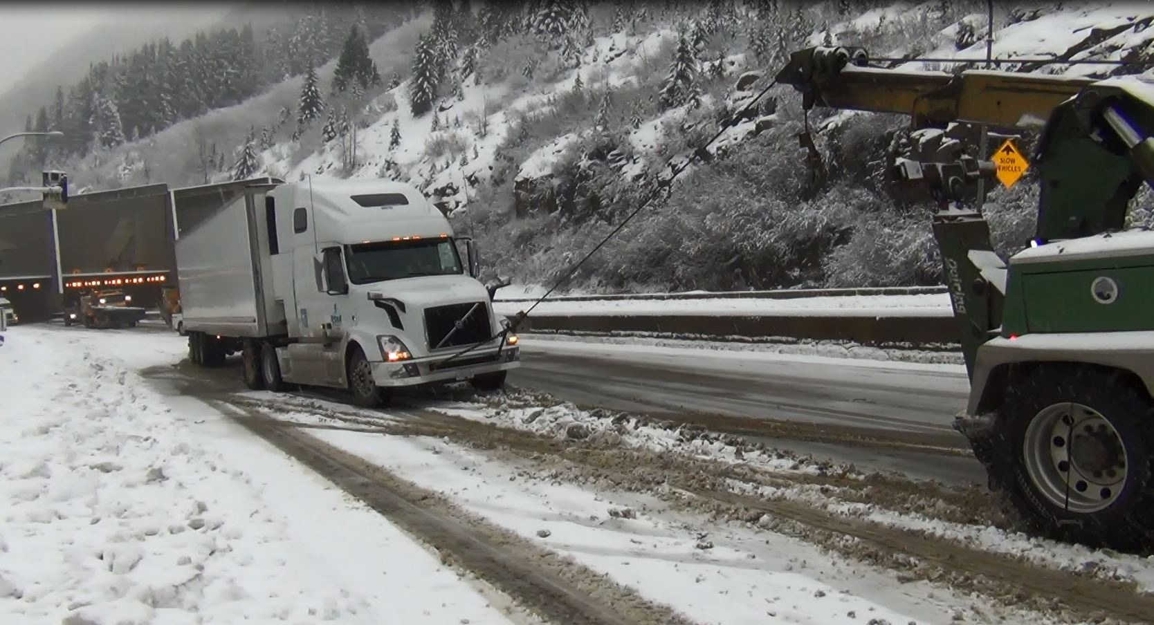 Commercial vehicle gets traction help from tow truck on Coquihalla