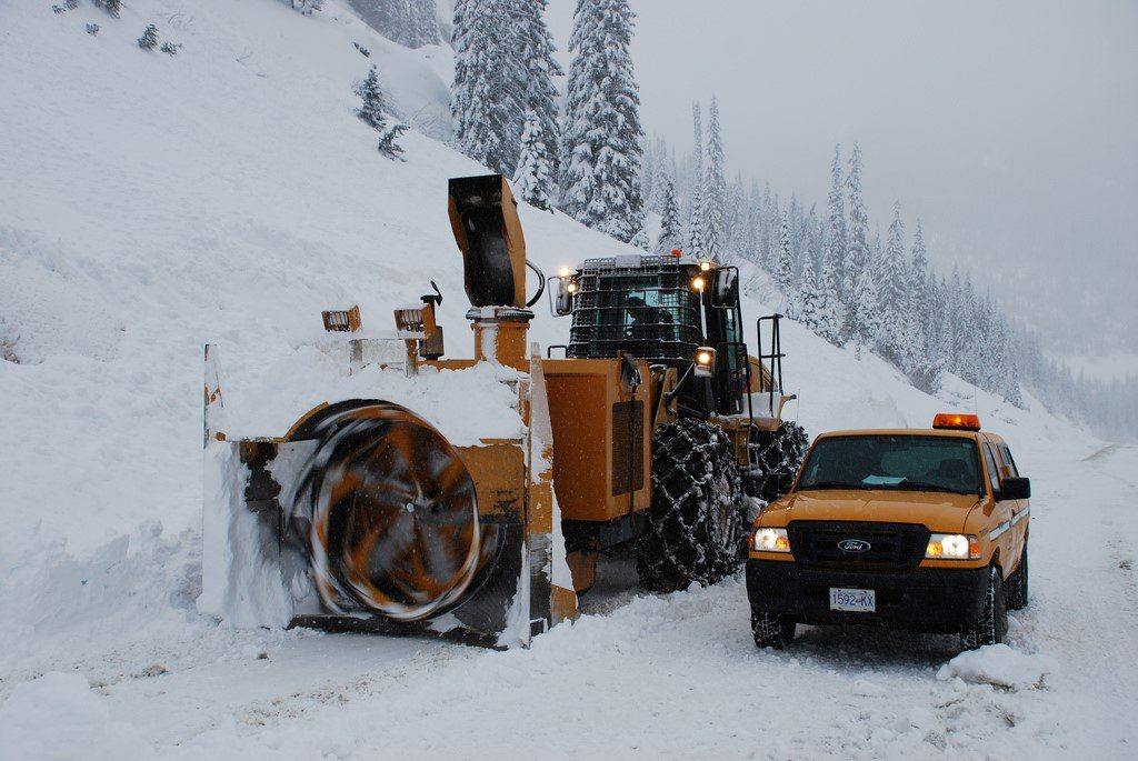 Loaders can also be equipped with snow blowers to chew through BIG deposits of snow, like this, following avalanche control work.