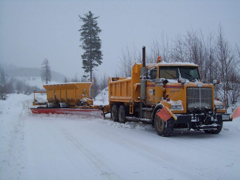 A tow plow attached to a plow truck.