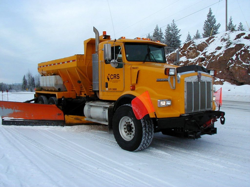 Wing plow and underbody plow working together to clear the highway.