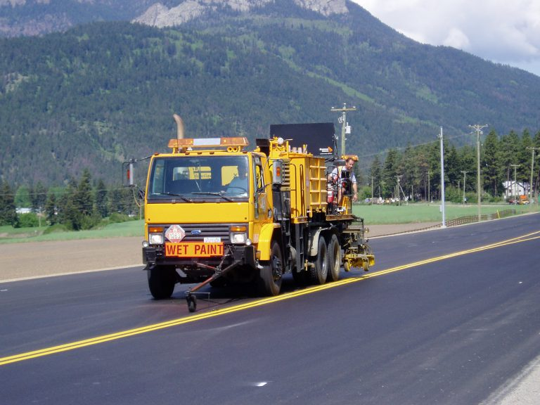 A line marking machine paints a stretch of highway in BC.