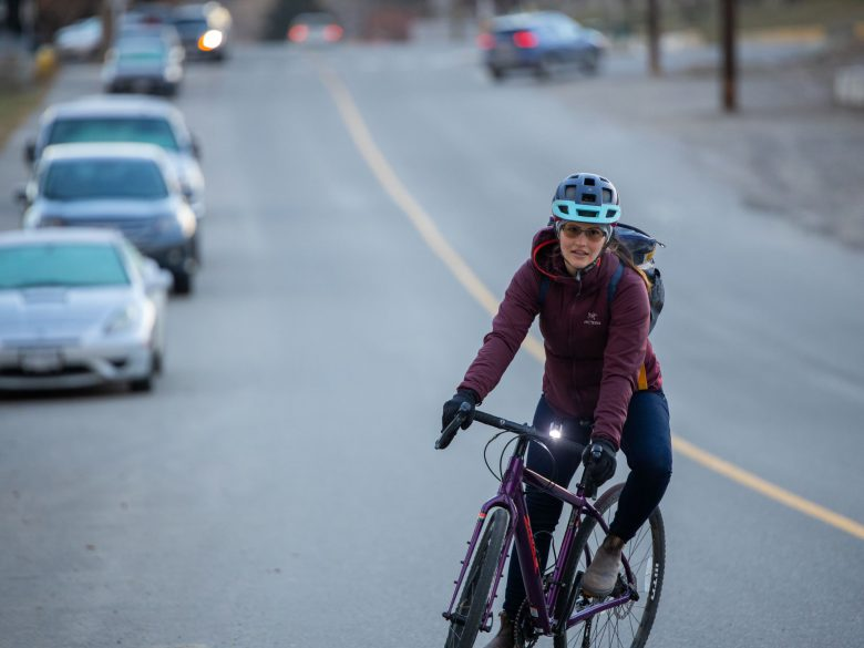 Woman riding bike on a cold day in Kamloops