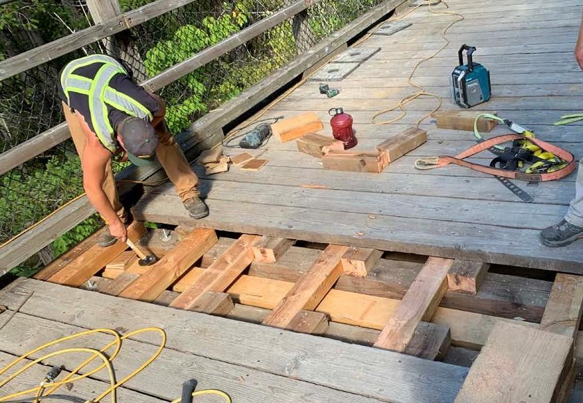 Worker upgrading trestle