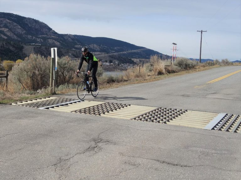 Cyclist travelling over retrofitted cattle guard
