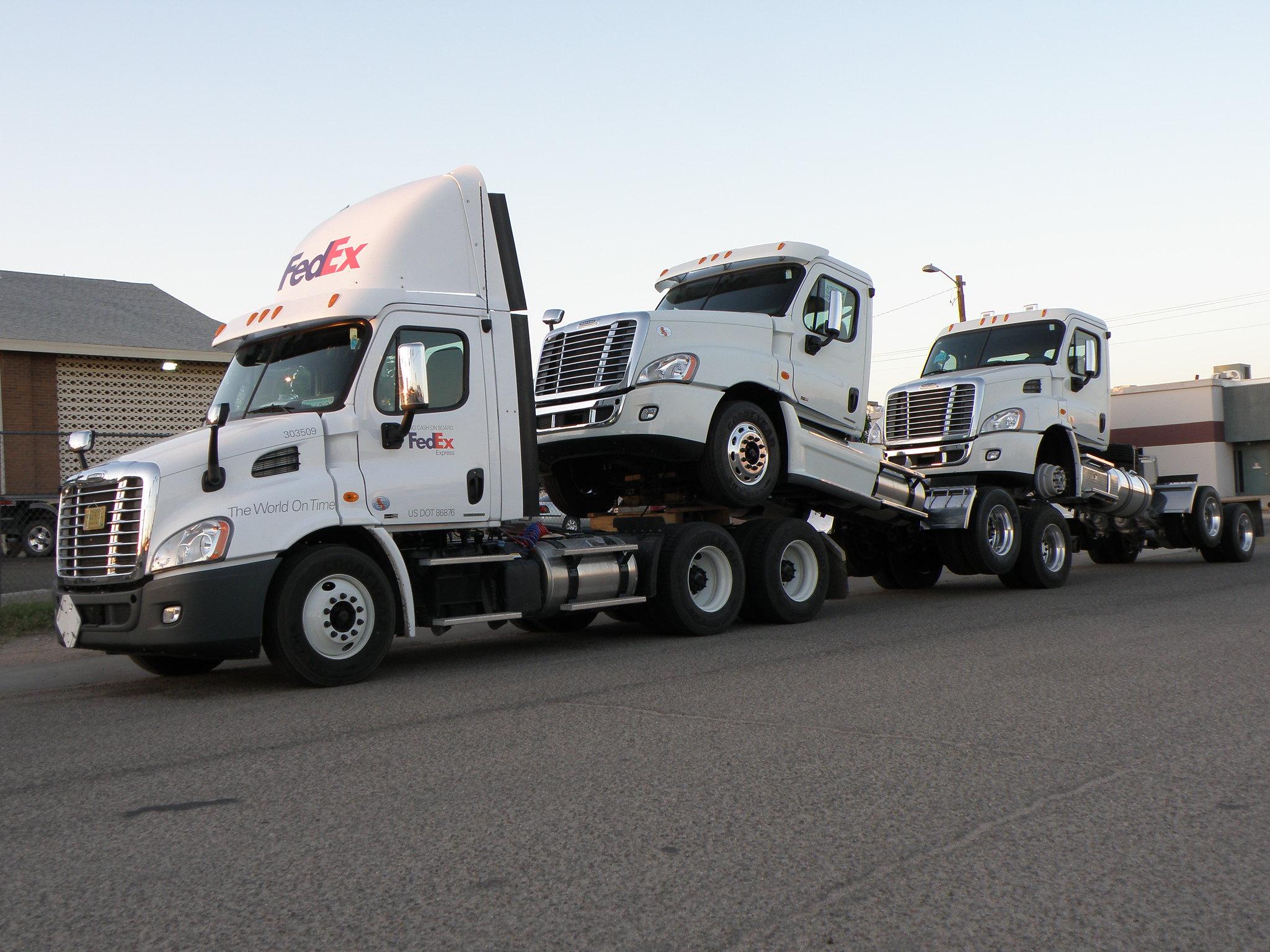 Three piggybacking trucks