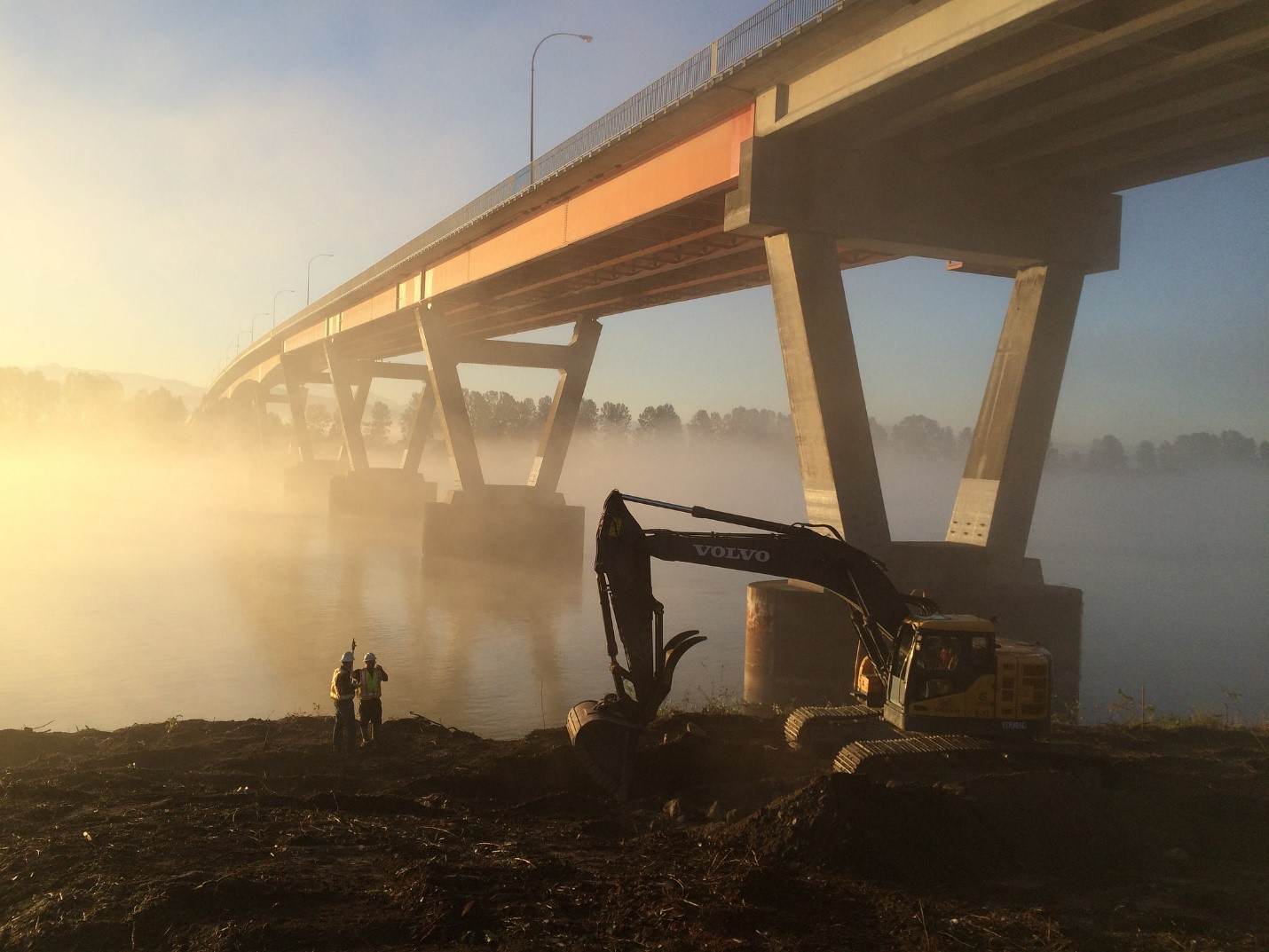 Workers at the site of the Mission River Bridge during seismic upgrades
